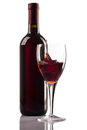 Red wine bottle and glass with splash on white background Royalty Free Stock Photo