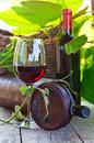 Red wine bottle and glass with in vineyard Royalty Free Stock Photos