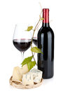 Red wine bottle, glasses and cheese Royalty Free Stock Photo