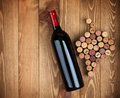 Red wine bottle and grape shaped corks Royalty Free Stock Photo
