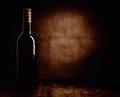 Red wine bottle the on the table dark brown theme and canvas background Stock Photos