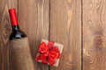 Red wine bottle and valentines day gift box Royalty Free Stock Photo