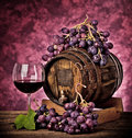 Red wine bottle and wine glass Stock Photography
