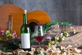 Red wine bottle and wine glass Royalty Free Stock Photography