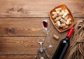 Red wine bottle, wine glass, bowl with corks and corkscrew Royalty Free Stock Photo