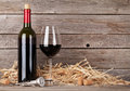 Red wine bottle and wine glass Royalty Free Stock Photo