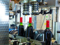Red wine in bottling machine at winery glass Royalty Free Stock Image