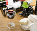 Red wine, Brie, Camembert and grape Stock Photography