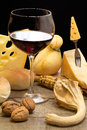 Red wine with cheese and autumnal decoration Stock Photography
