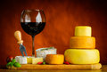 Red Wine and Cheese Wheel Royalty Free Stock Photo