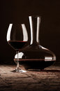 Red wine in decanter on rustic stone floor Stock Image