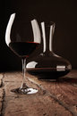 Red wine in decanter on rustic stone floor Royalty Free Stock Images
