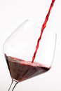 Red wine falling in a crystal glass Stock Photos