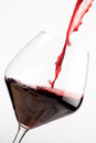 Red wine falling in a crystal glass Stock Image