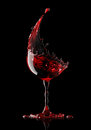 Red wine glass on black background Royalty Free Stock Photo