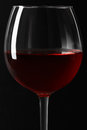 Red wine glass close up on black background Royalty Free Stock Photo