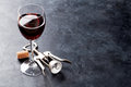 Red wine glass and corkscrew Royalty Free Stock Photo