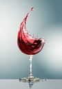 Red wine glass on gray background