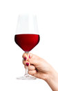 Red wine glass in hand female Royalty Free Stock Image