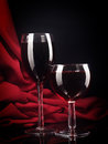 Red wine glass on a silk background Stock Photo