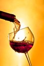 Red wine in the glass tilted Royalty Free Stock Photo