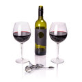 Red wine in glasses with bottle and corkscrew over white Stock Images