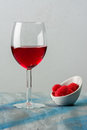 Red wine in a goblet on a abstract color background Royalty Free Stock Photos
