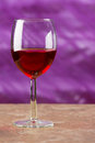Red wine in a goblet on a abstract color background Stock Photos