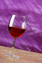 Red wine in a goblet on a abstract color background Royalty Free Stock Image