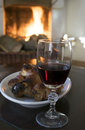 Red wine goblet and roast piglet round the fireside Royalty Free Stock Photo