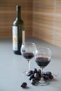 Red wine and grapes two glasses the bottle of on the table Stock Photography