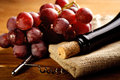 Red wine and grapes in vintage setting Stock Photography
