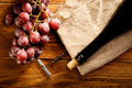 Red wine and grapes in vintage setting Royalty Free Stock Photos