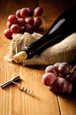 Red wine and grapes in vintage setting Royalty Free Stock Image
