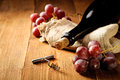 Red wine and grapes in vintage setting Royalty Free Stock Photography