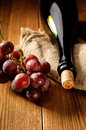 Red wine and grapes in vintage setting Stock Image