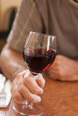 Red wine in hand Royalty Free Stock Photo