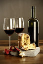 Red wine and panettone two glasses of bottle with christmas ornament selective focus on Royalty Free Stock Images