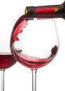 Red wine pour a glass of being poured from a bottle Royalty Free Stock Image