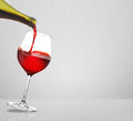 Red wine pouring on a gray background Stock Image