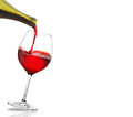 Red wine pouring on a white background Stock Photo