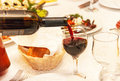 Red wine pouring into a wine glass, that standing on the  table. Royalty Free Stock Photo