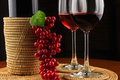 Red wine on rattan Royalty Free Stock Images