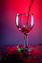 Red wine and red rose Stock Photos
