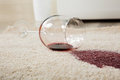 Red Wine Spilled From Glass On Carpet Royalty Free Stock Photo