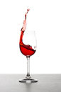 Red wine splash over white background Stock Images