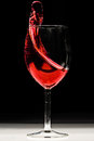 Red wine splash splashing on black background Stock Image