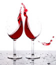 Red wine splash in two glasses with white background Stock Image