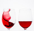 Red wine splash in two glasses with white background Stock Photography
