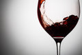 Red wine splashing in glass, beautiful alcoholic beverage Royalty Free Stock Photo